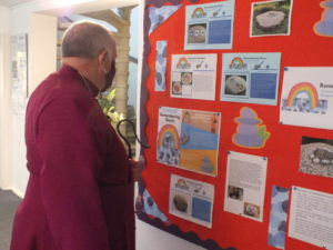 Bishop David looking at the stories board at St Mark's