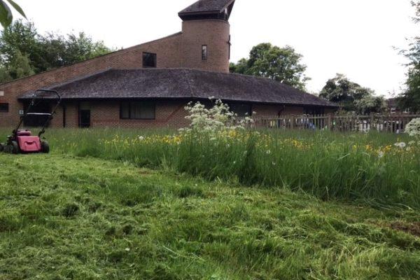 Cut grass around the church
