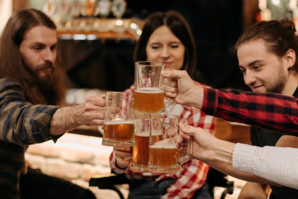 People sharing drinks in a pub