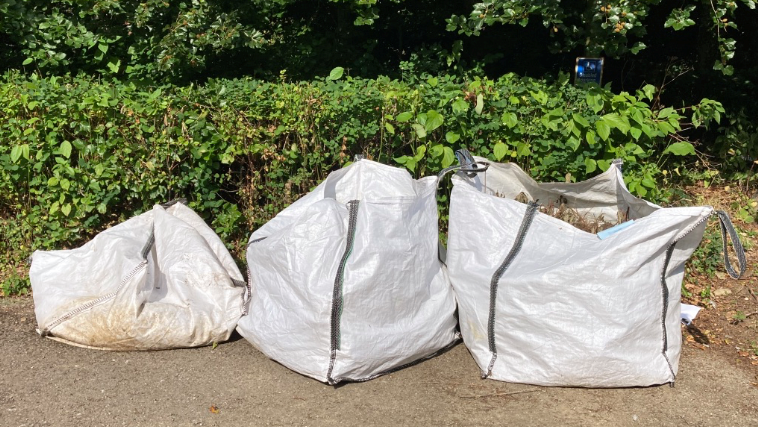 Bags of garden waste in large bags