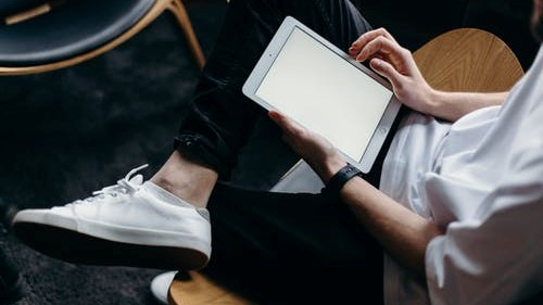 male holding a tablet